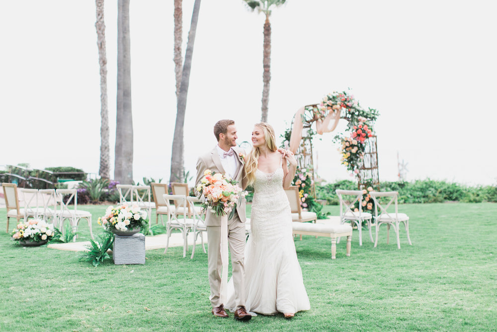 Bride and Groom at Ole Hanson Beach Club wedding in San Clemente, Ca with wedding photographer Lovisa Photo.