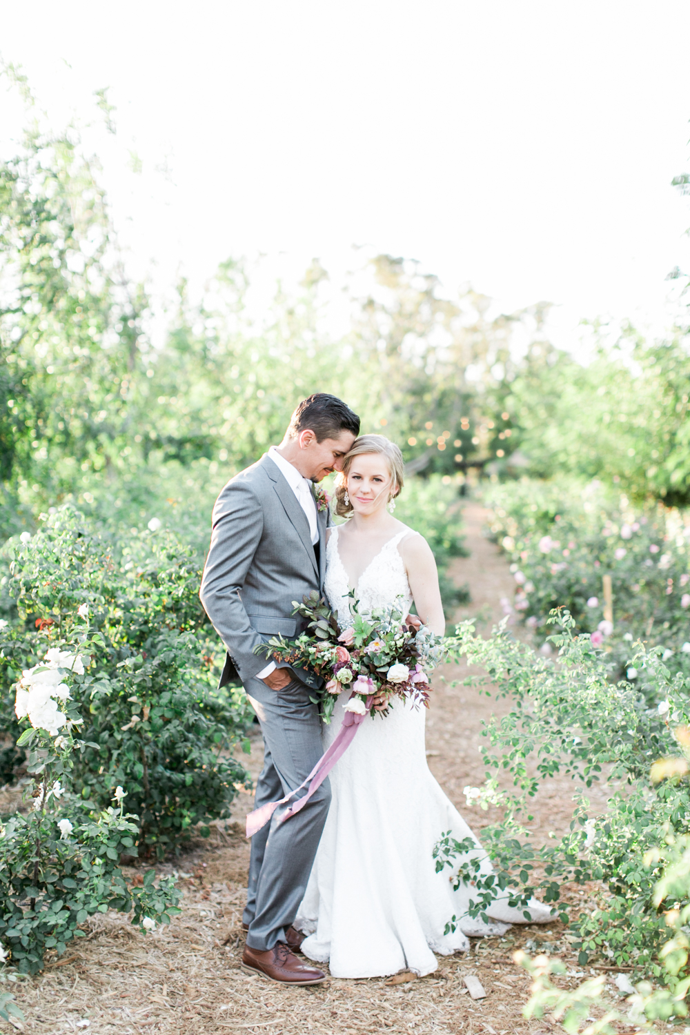 Bride and groom take wedding photos at the Walnut Grove in Moorpark, Ca.