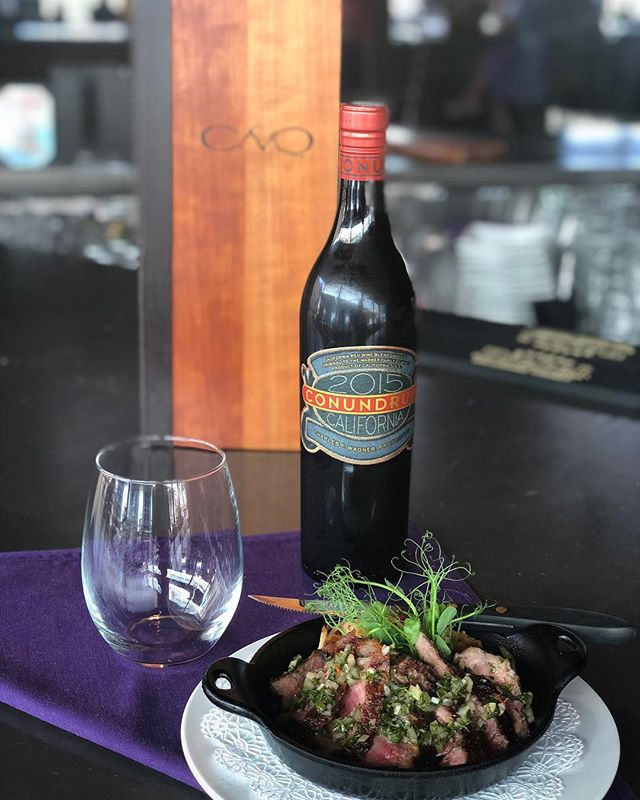 It's happy hour at Cavo! Come in and enjoy our NY Strip (6 oz) topped with our house made chimichurri served with pan fried potatoes. Pairs well with Conundrum, Red Blend (2015) only $30 on happy hour! 🍷