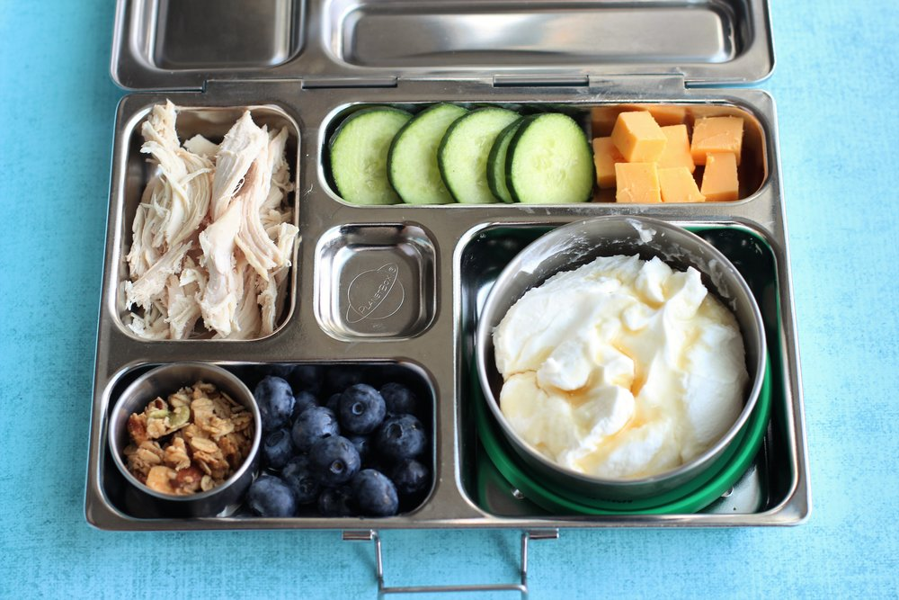 Shredded rotisserie chicken, sliced cukes, cheese cubes, Greek yogurt with maple syrup, granola and blueberries