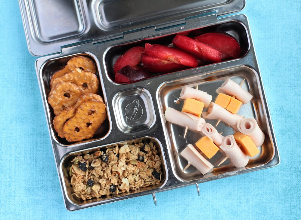 Pineapple, grape tomatoes, leftover rice pilaf, veggie straws, and hummus/cheese/honey mustard/veggie wrap