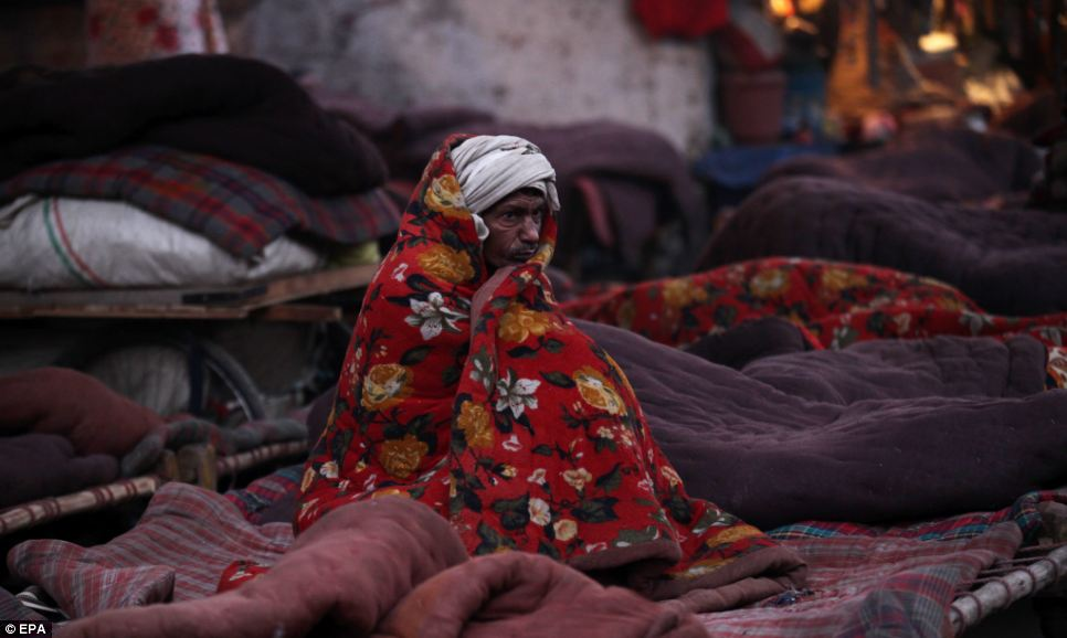 Image Courtesy: http://www.dailymail.co.uk/news/article-2533435/Freezing-slums-India.html