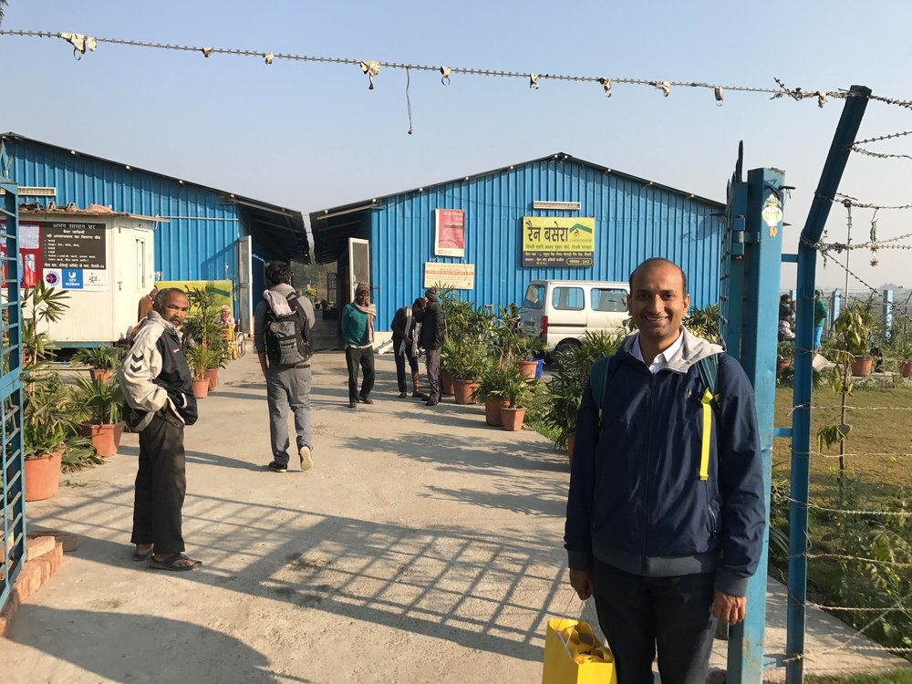 billionBricks Founder & CEO Prasoon Kumar in front of Geeta Ghat Homeless Shelter for Men, managed by Centre For Equity Studies/ Aman Biradiri
