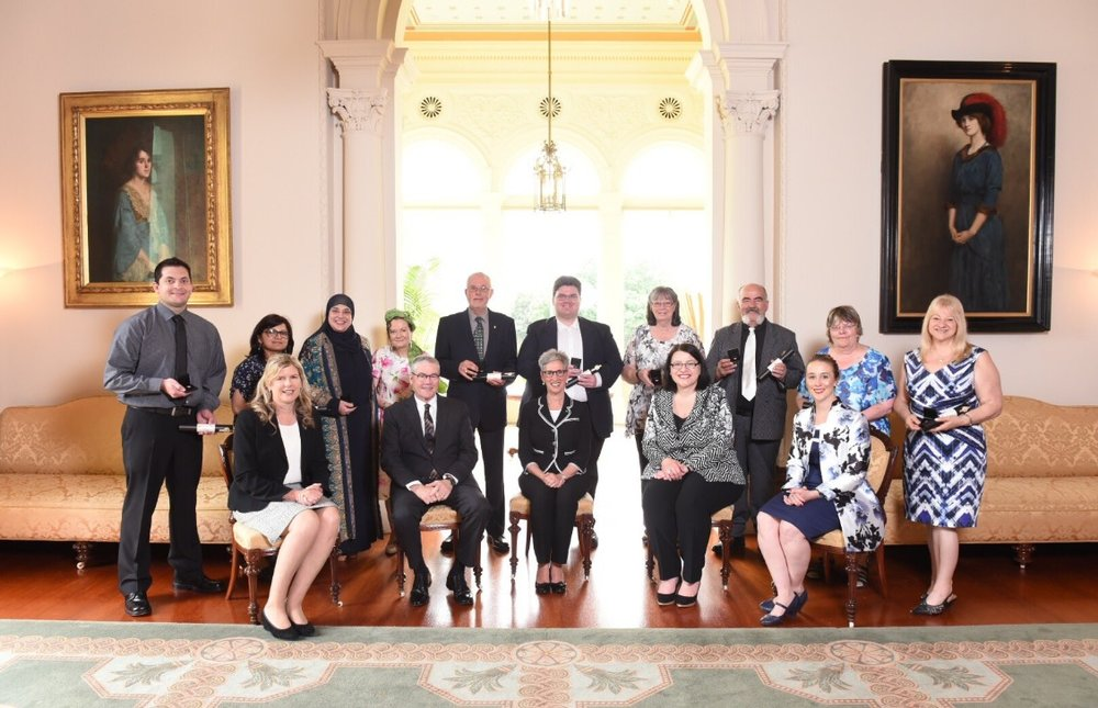 Representing the Emergency Relief Team at the time of the Awards are: (back row) David Arche, Pratima Sharma, Lina Shaaban, Marie-Louise Drew, John Coppola, James Cameron, Violet Murphy, Con Hatzi, Sue Pinchbeck, Albina Dal Santo.    The Honourable Linda Dessau AM, Governor of Victoria seated centred.