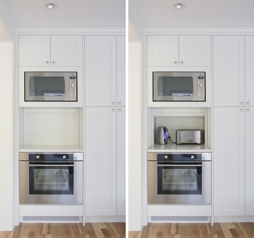 White Tambour applience garage with shaker kitchen.jpg