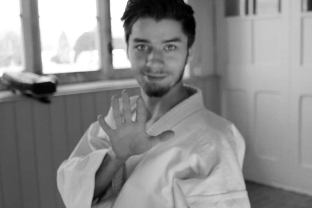 Instructor and young Sensei, Aaron Daniel 2nd Dan, practices  kung fu  in addition to  shito ryu karate