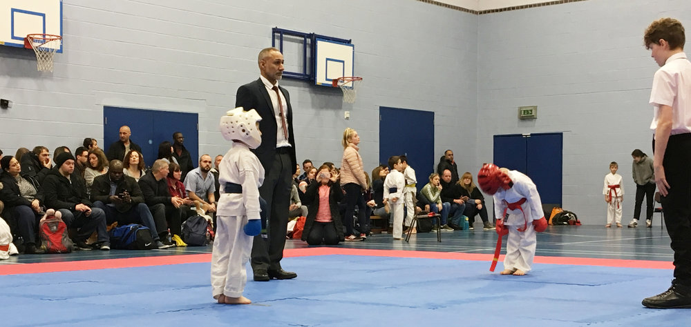 SKB Chief Instructor David Judah Daniel 4th Dan judging at a competition in 2018
