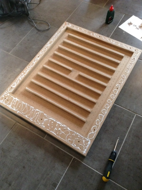 On the reverse, an air chamber is created, which will be then be sealed with the base panel of the table. 'Spacers' are added between the holes to distribute the air flow.