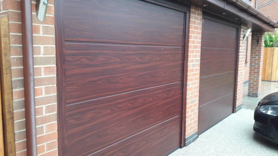 To this.............. Hormann L ribbed sectional garage doors in rosewood complete with Hormann Promatic garage door openers