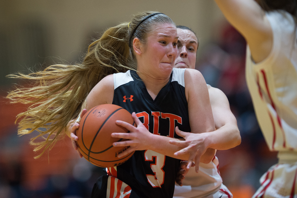 RIT Tigers Jessica Glaz, 3, receives a foul from RPI Engineers Bailei Tetrault, 13, in the 3rd quarter in the Clark Gym on the Rochester Institute of Technology campus in Henrietta, N.Y. on Jan. 29, 2016. The Tigers went on to defeat the Engineers 68-64.