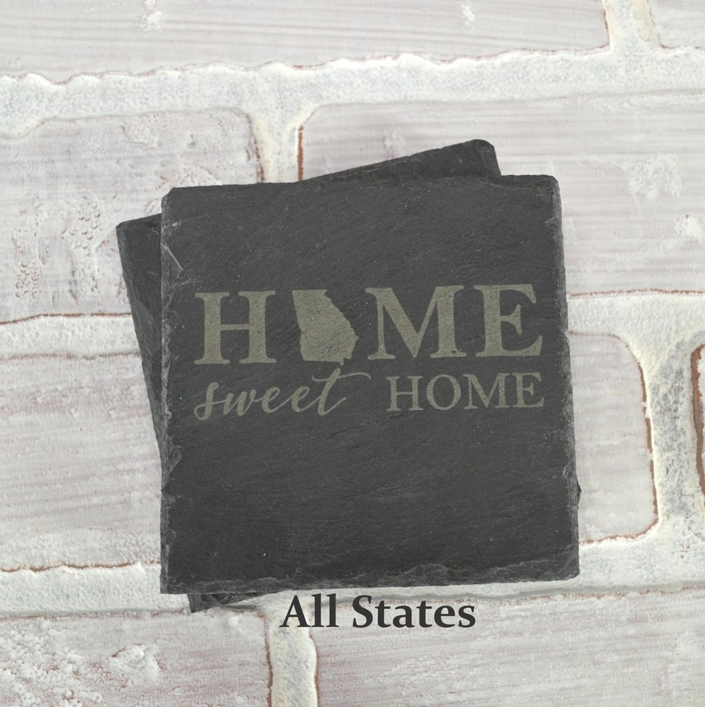 Slate coasters with rubber feet. Both sides can be engraved for a unique personalized gift.