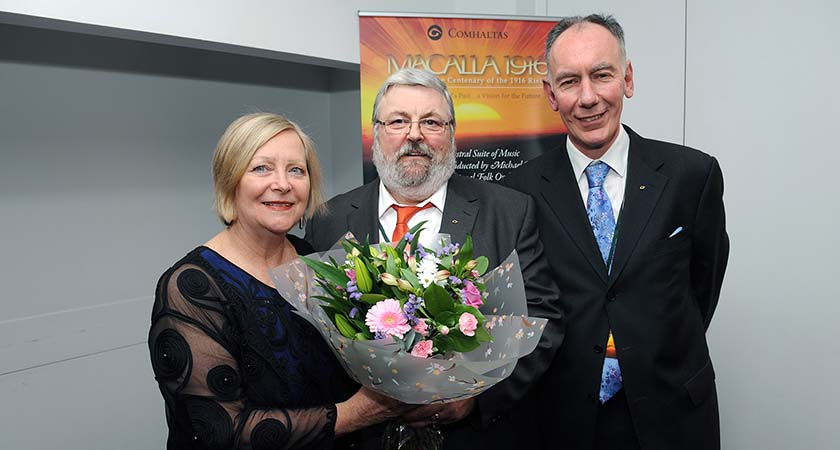 Greta Mulhall was presented with flowers by Seamus Brogan and Michael Nevin from Comhaltas Ceoltóirí Éireann.  Photo by  Malcolm McNally