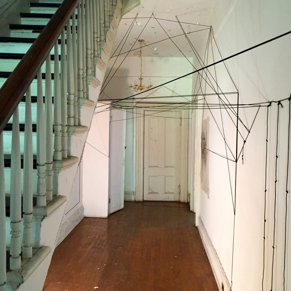 """Open House,"" Susan Hoffman Fishman and Elena Kalman. Parachute Cord, Charcoal and Plastic Sheeting. Governor's Island, NYC, 2015. Site Specific Installation Completed at Art Kibbutz Summer Residency."
