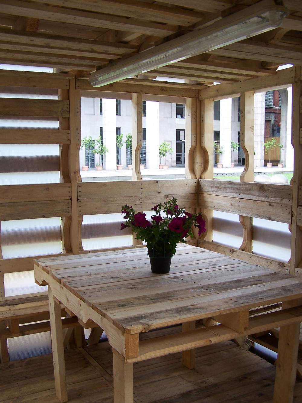 Pallet House from inside _ Milan photo by Suzan Wines,Dining room.jpg
