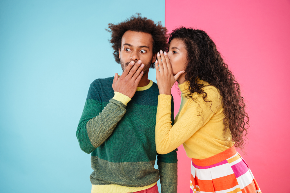 graphicstock-beautiful-curly-young-woman-telling-secrets-to-her-boyfriend-over-colorful-background_BdNZRSU2x.png