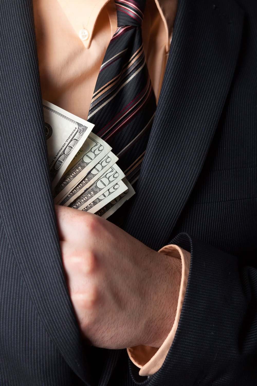 close-up-of-a-business-mans-hand-hiding-money-in-his-suit-jacket-pocket_HtgbyuvCBi-sm.jpg