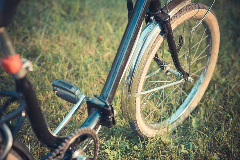 graphicstock-close-up-of-a-vintage-bike-on-the-grass_H6lqaUQjyb-small.jpg