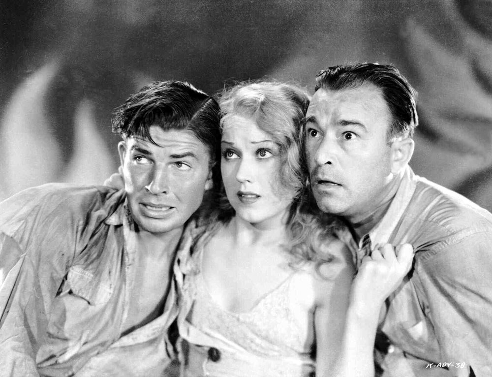 Bruce Cabot, Fay Wray, and Robert Armstrong, presumably looking agog at Kong. Don't be fooled, this is a press photo, the three actors never actually stood like this behind what looks like, I dunno, a satin sheet or something?