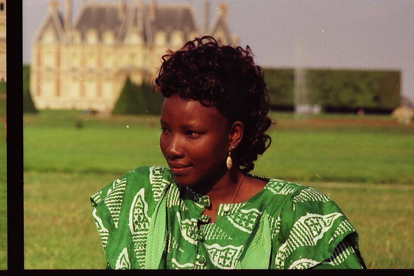 Malian woman by castle