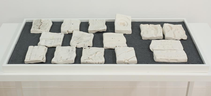 Liene Bosquê     Peekskill - NY, Walk I, September 27,  2015    Paper clay, carborundum grits and public participation    6 x 4 x 1 inches (aprox. each piece)    15 pieces