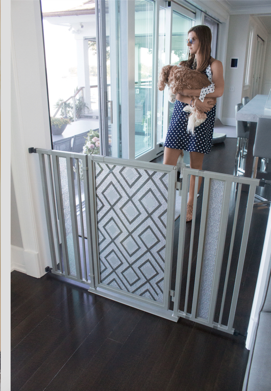 "My beautiful niece Abby holds Chelsea behind a 54"" Fusion Gate framed in Satin Nickel with a Gray Diamonds art screen"