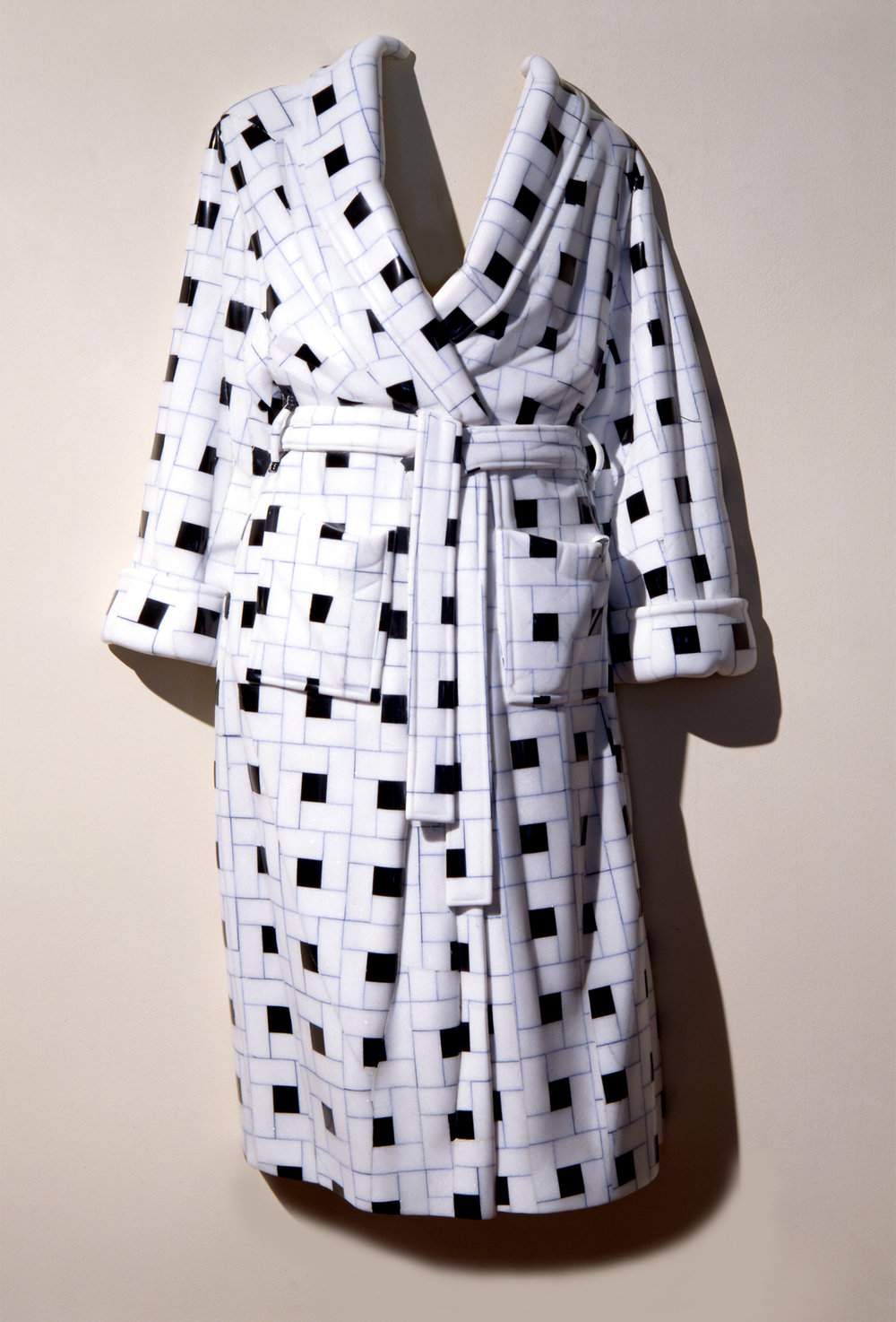 Bathrobes & Aprons  Interlocking patterns, intricate plaids and intarsia designs suggest power struggles both intimate and observed.
