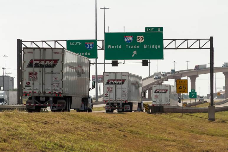 SPECIAL TO THE DEMOCRAT-GAZETTE P.A.M. Transportation trucks cross the Mexico border at Laredo, Texas.