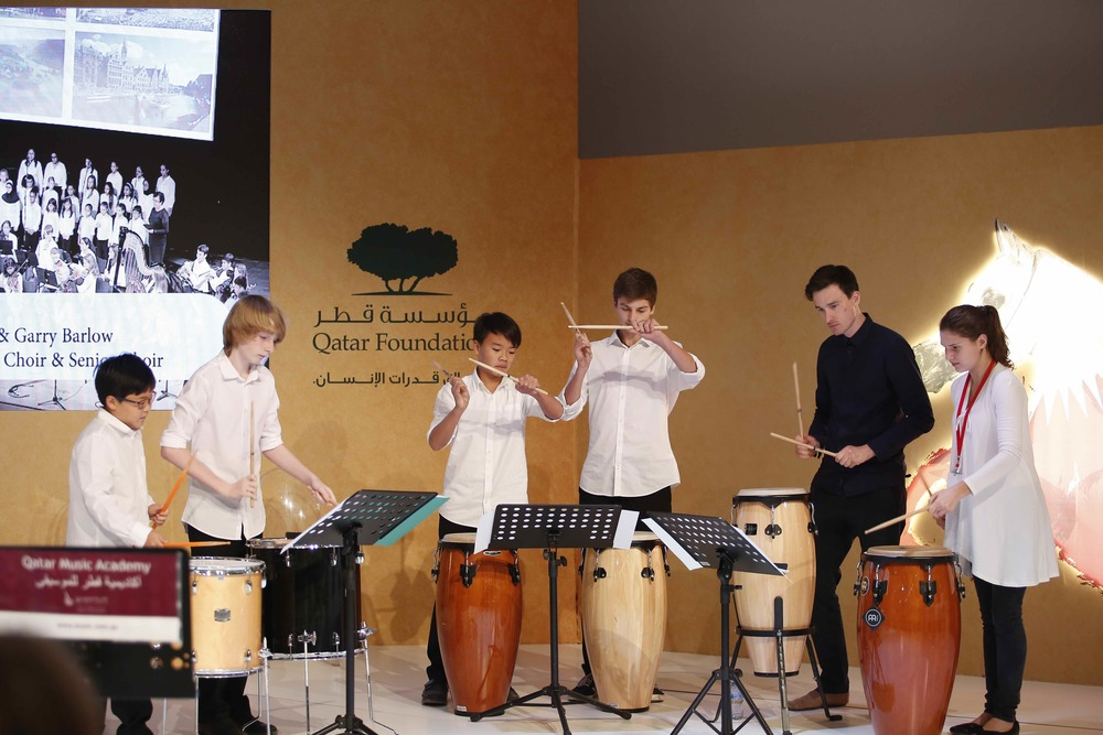 Performing with the Qatar Music Academy's Senior Percussion Ensemble
