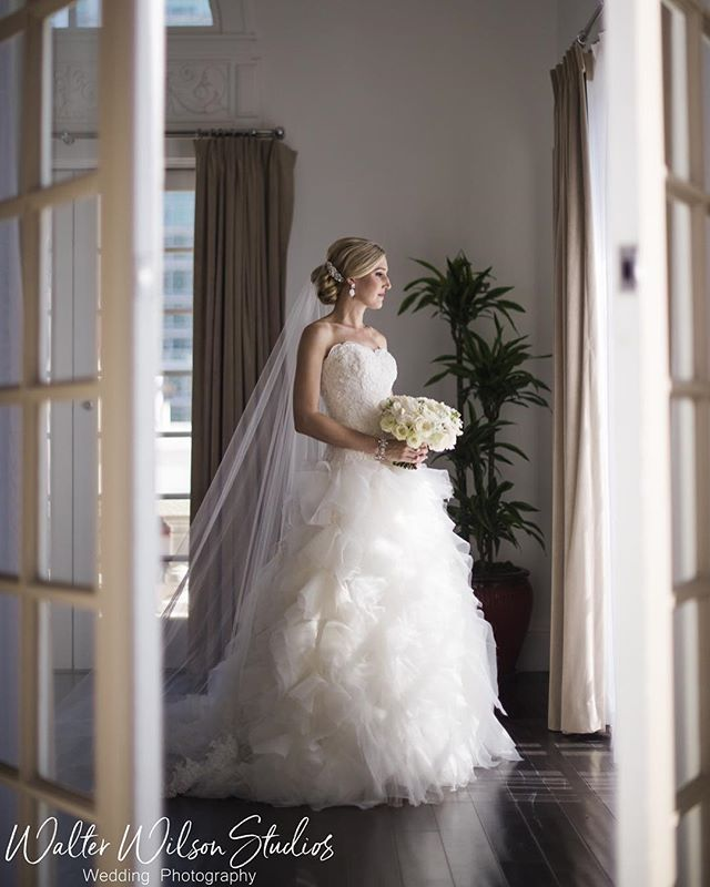 The beautiful bride, only an hour away from walking down the isle to see the love of her life.