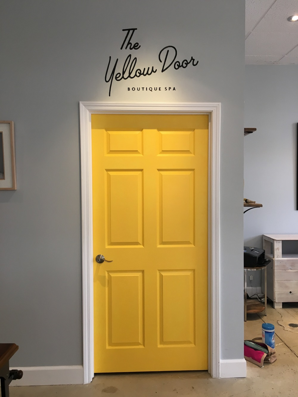logo paint on The Yellow Door Boutique Spa materials: pencil, black paint