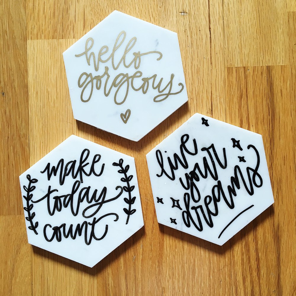 marble coasters with lettering materials: hexagon marble pieces, paint pens
