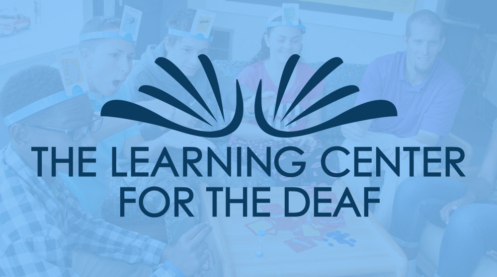 "This logo holds many meanings—an abstraction of the ASL depiction of the sign for ""inspiration,"" it captures the impact on those enriched through the services they receive from TLC. The logo also symbolizes the following: hands waving, a sign expression for applause and celebration; the TLC Sign Name ""I Love You""; books, the gateway to the English Language; and finally, a butterfly, an animal believed to be deaf and a symbol of the deaf community in many countries."