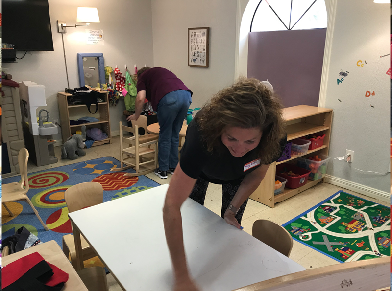Mary Beth getting the nursery area of the Respite Center ready for the kids.