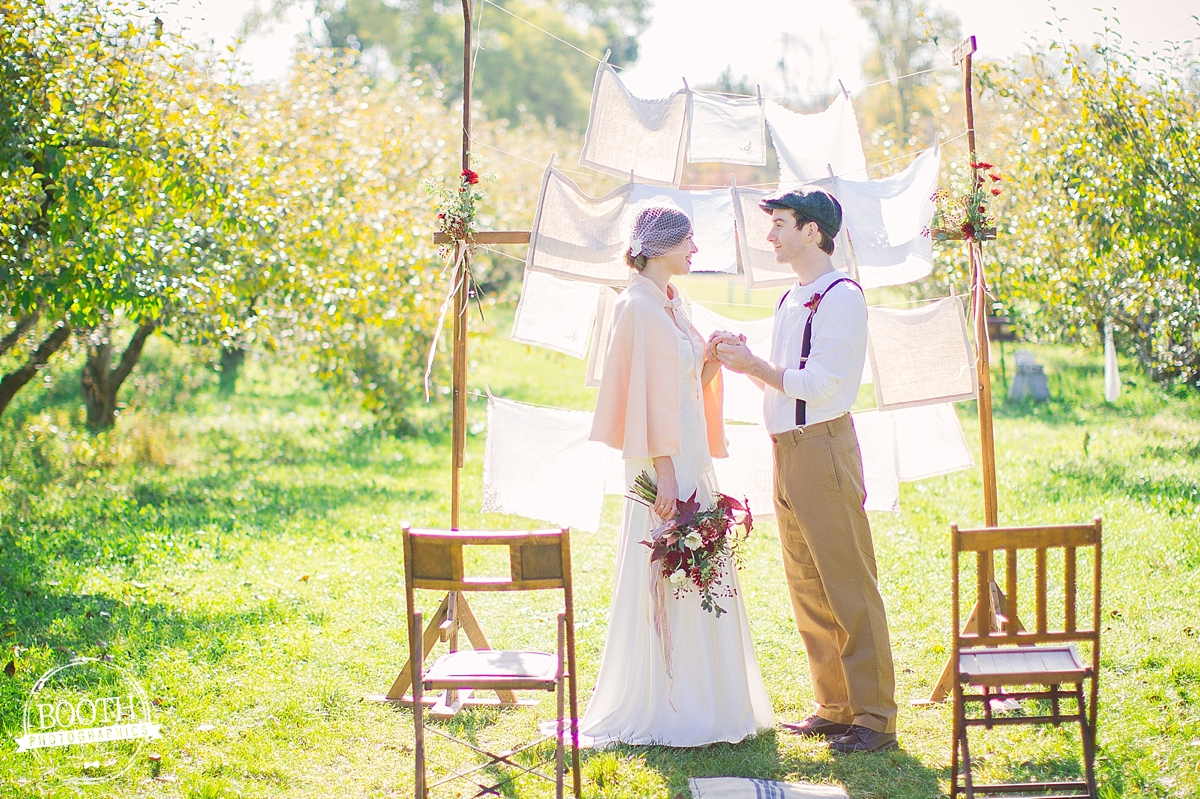 couple at their wedding ceremony at Door Creek Orchard in Madison, WI