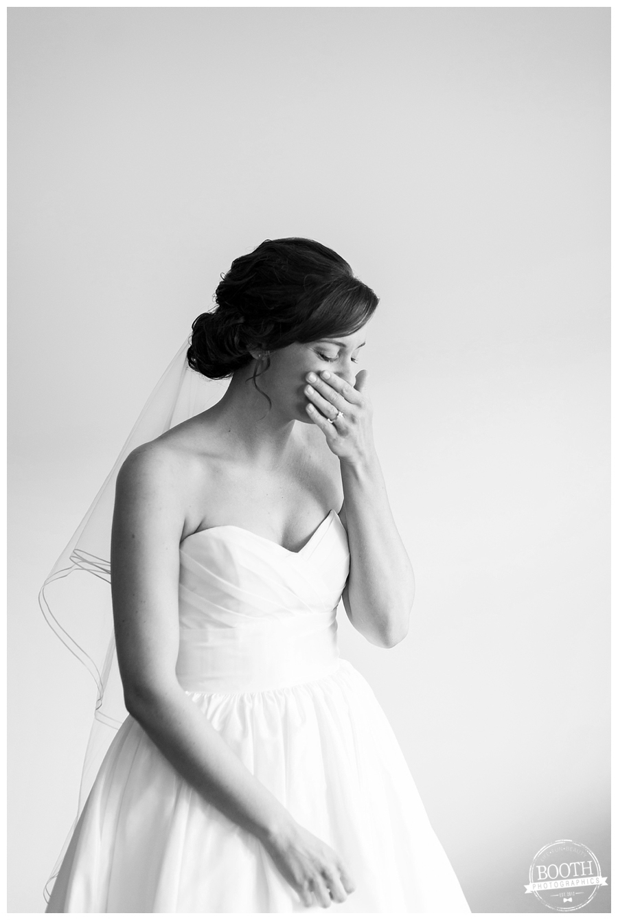 bride thinking about her groom and tearing up in her wedding dress