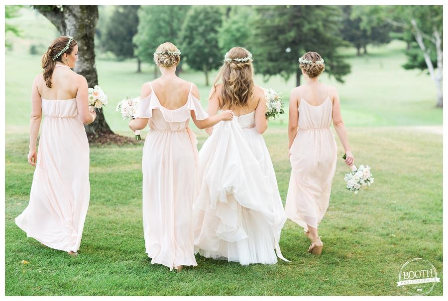 bridesmaids walking together at a bohemain Wisconsin wedding
