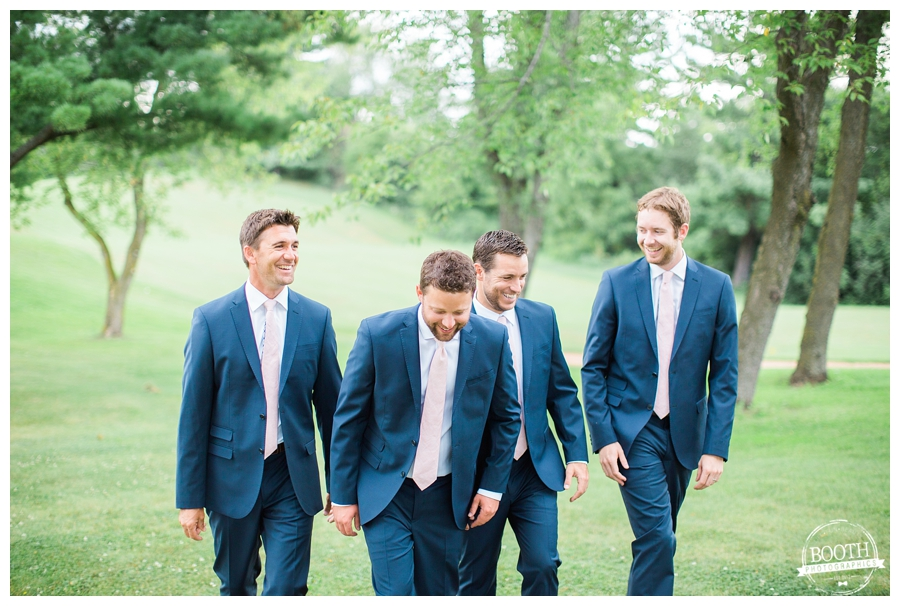 groomsmen walking together at a Madison, Wisconsin country club wedding