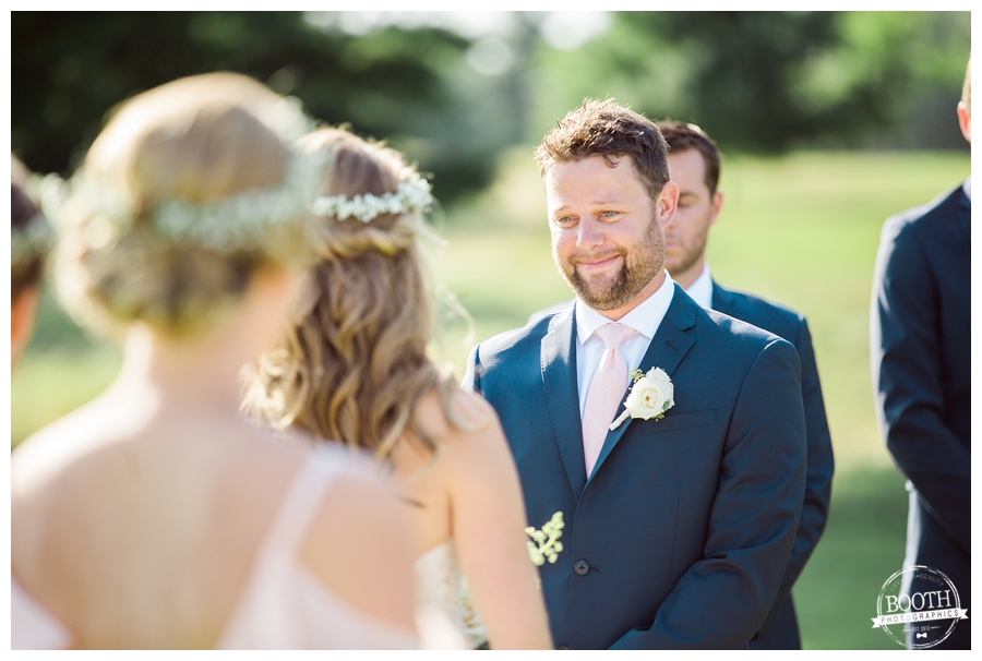 groom looking lovingly at his bride during their outdoor wedding ceremony