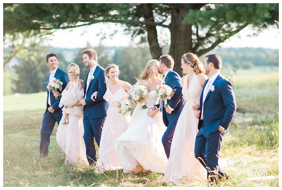 bridal party walking together at an outdoor wedding in Wisconsin