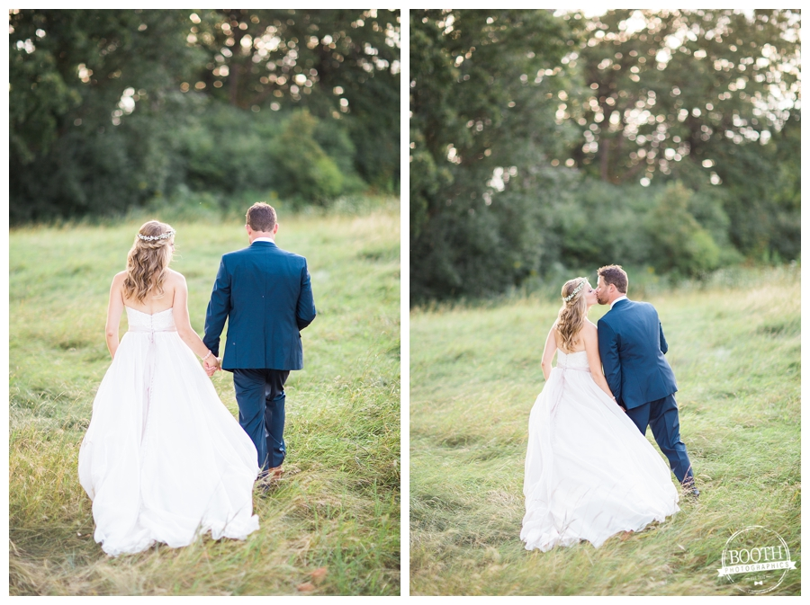 couple walking and kissing at their outdoor wedding