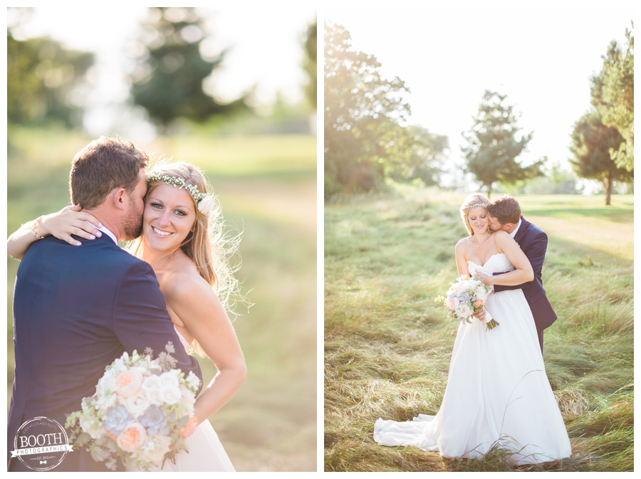 couple embracing in a grassy field on their wedding day