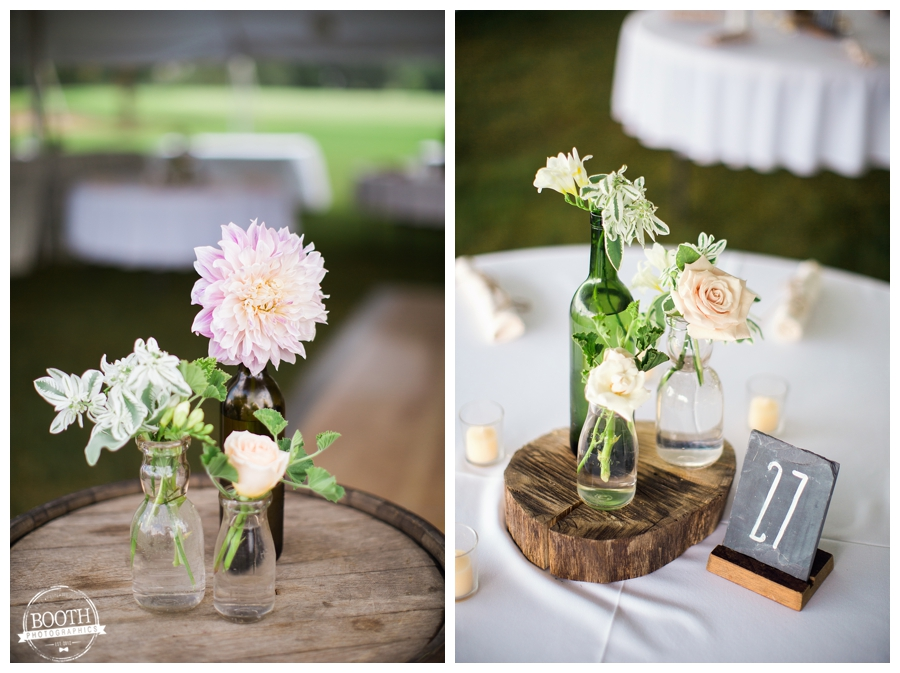 wedding reception florals on tables at an outdoor tent wedding