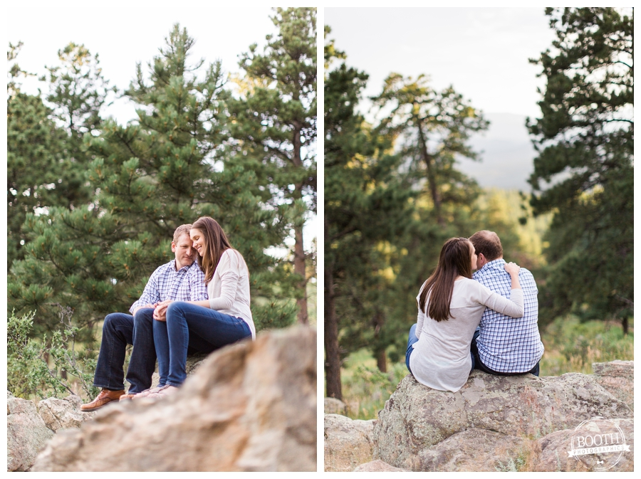 couple snuggling on a rock in the rocky mountains near Denver, Colorado