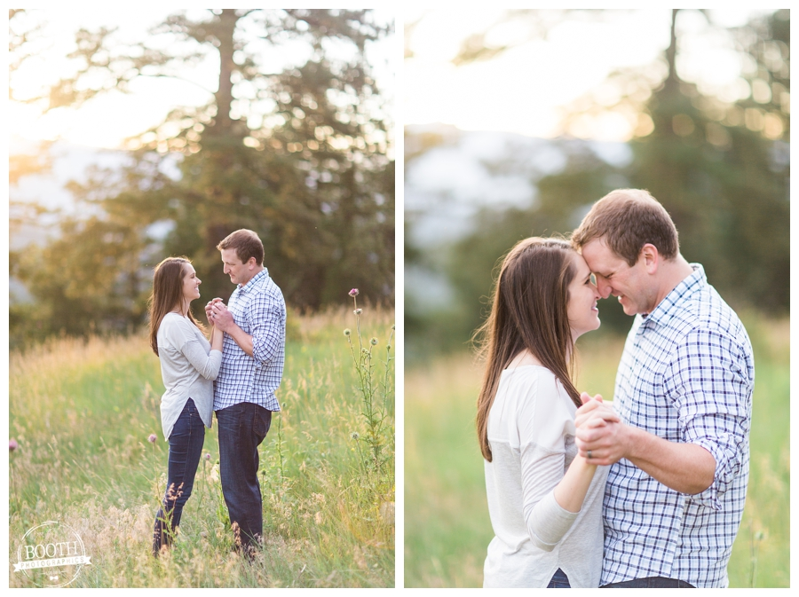 couple in a meadow for their mountain engagement session in Denver, Colorado
