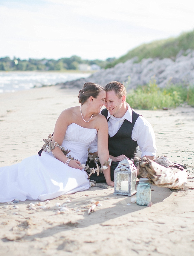 bride and groom on a beach on their wedding day