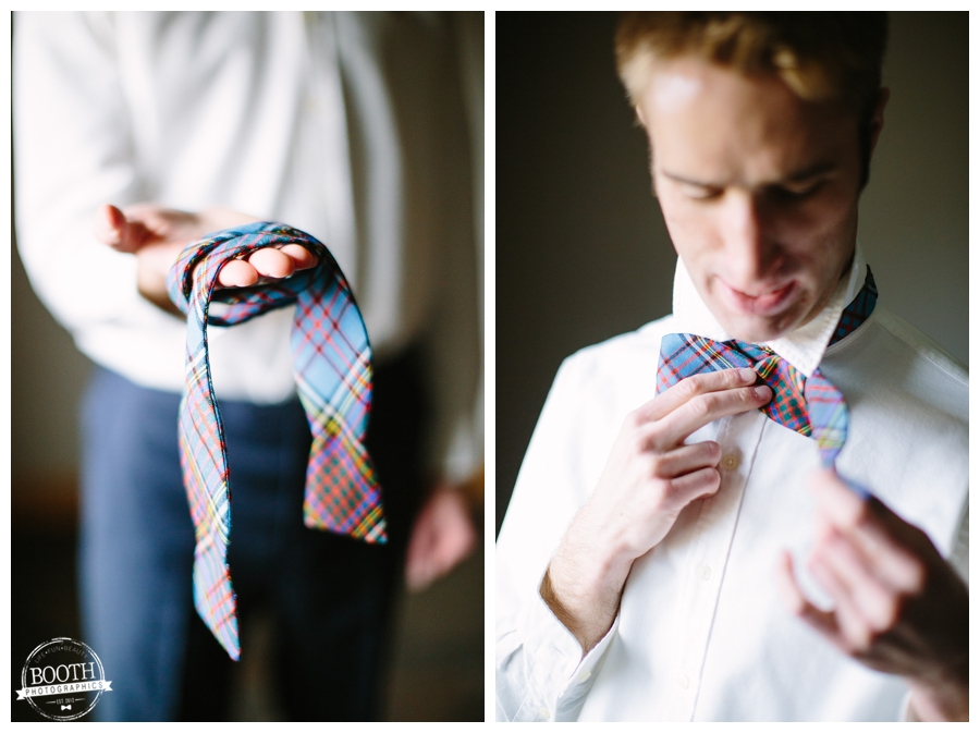 groom holding his bow tie