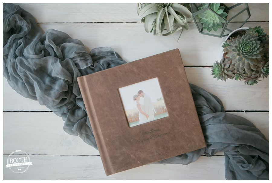 wedding album on coffee table with succulents, Booth Photographics, Destination Fine art Wedding photography
