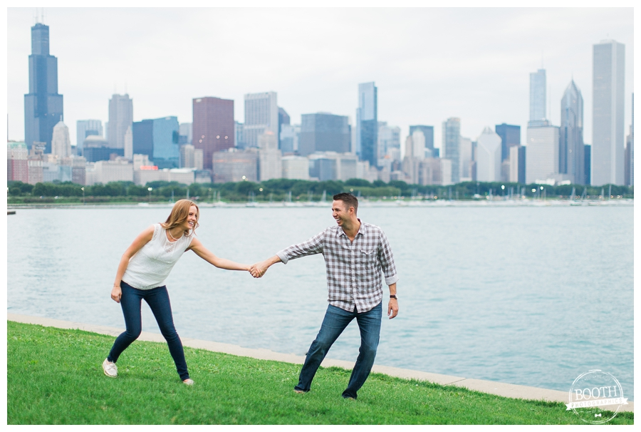 couple playing tug of war at Northerly Island in front of the Chicago Skyline