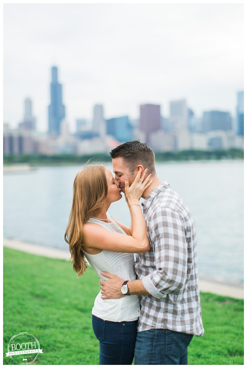 couple kissing at Northerly Island in front of the Chicago Skyline