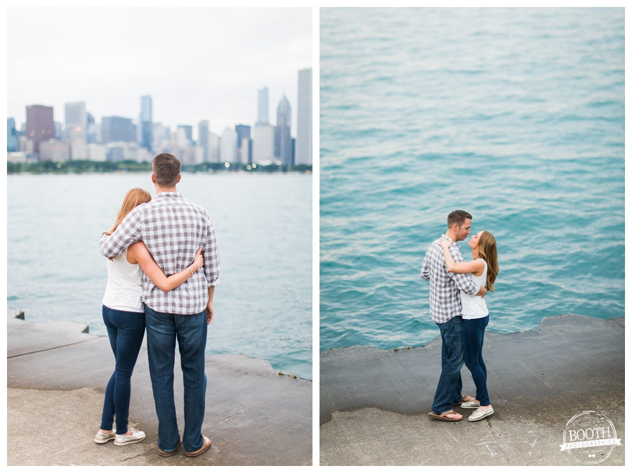 cute engaged couple standing at the edge of Lake Michigan looking out at the water